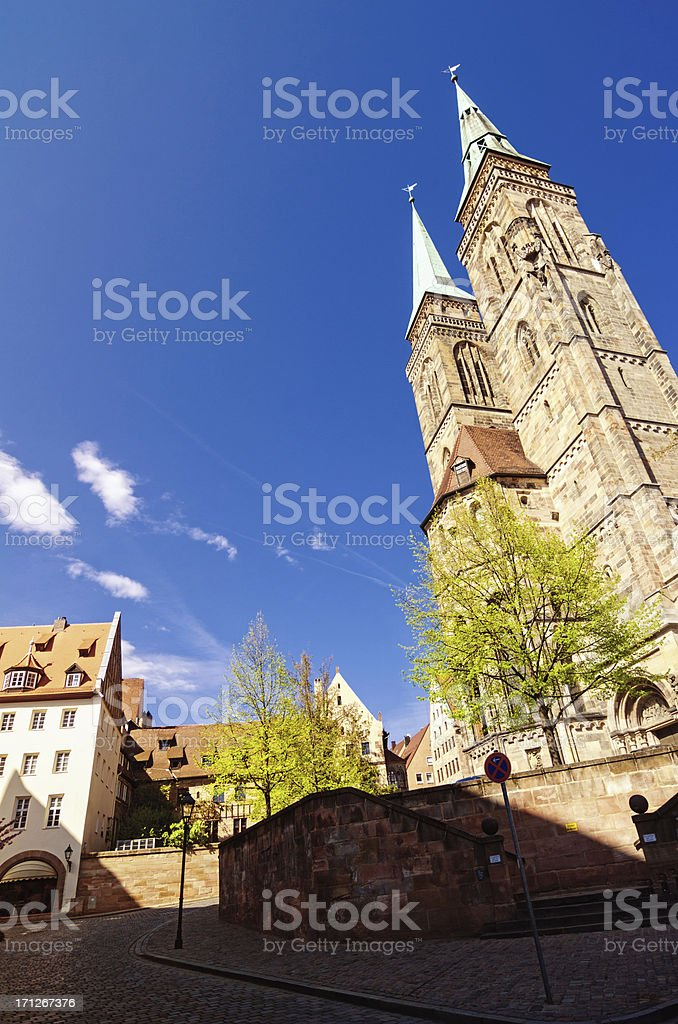 St Sebaldus Church and cobblestone street in Nuremberg stock photo