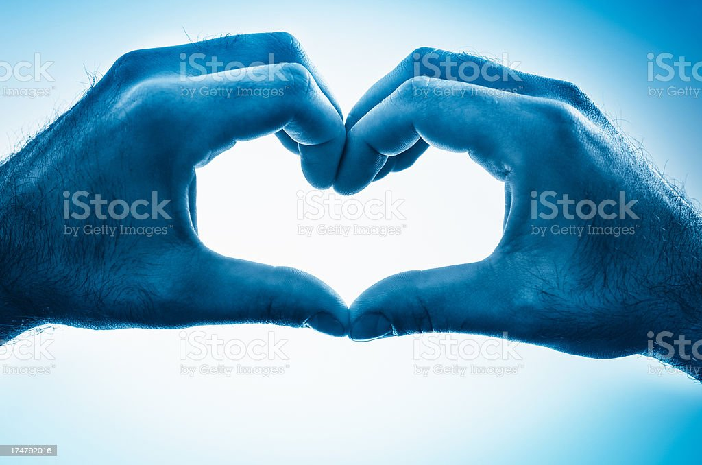 St. Valentine hands on blue royalty-free stock photo
