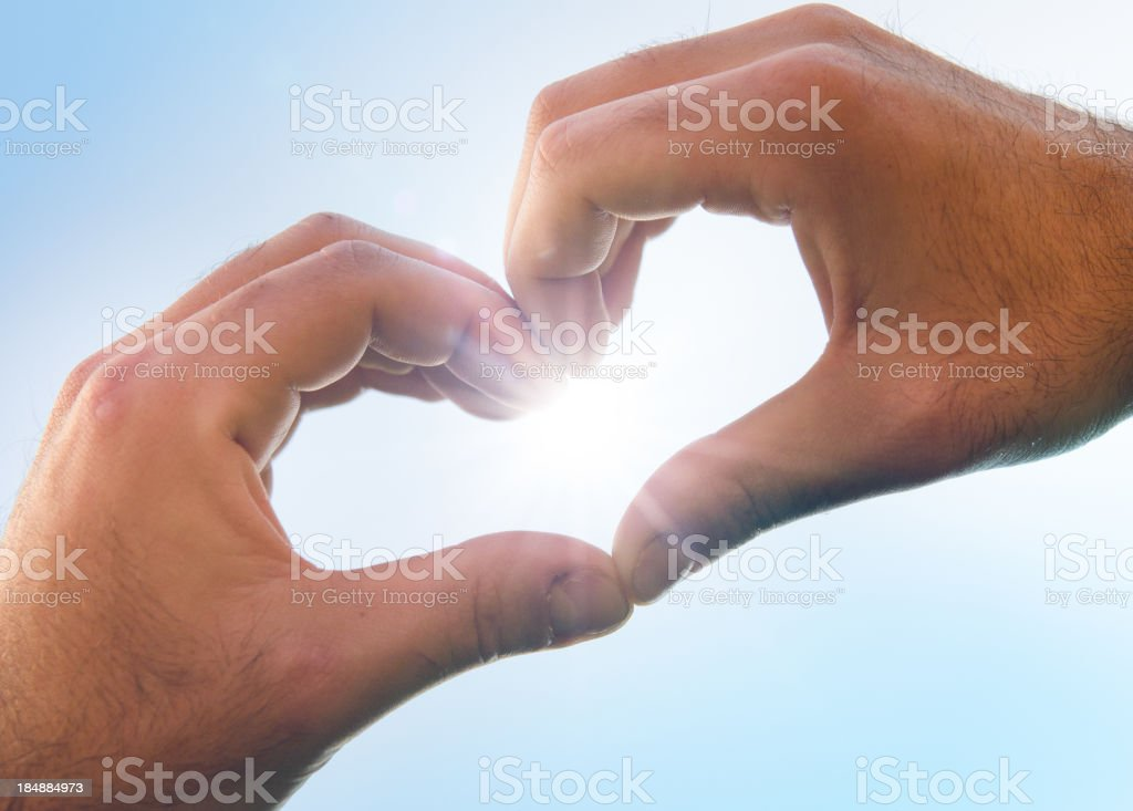 St. Valentine hands on blue sky royalty-free stock photo