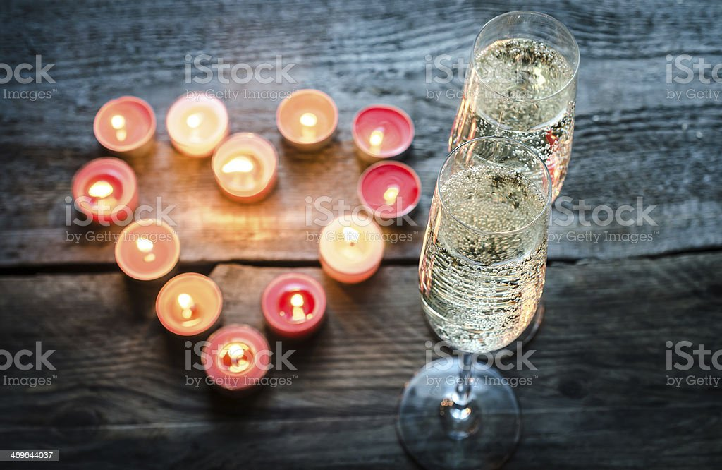 St Valentine's day candles with champagne stock photo