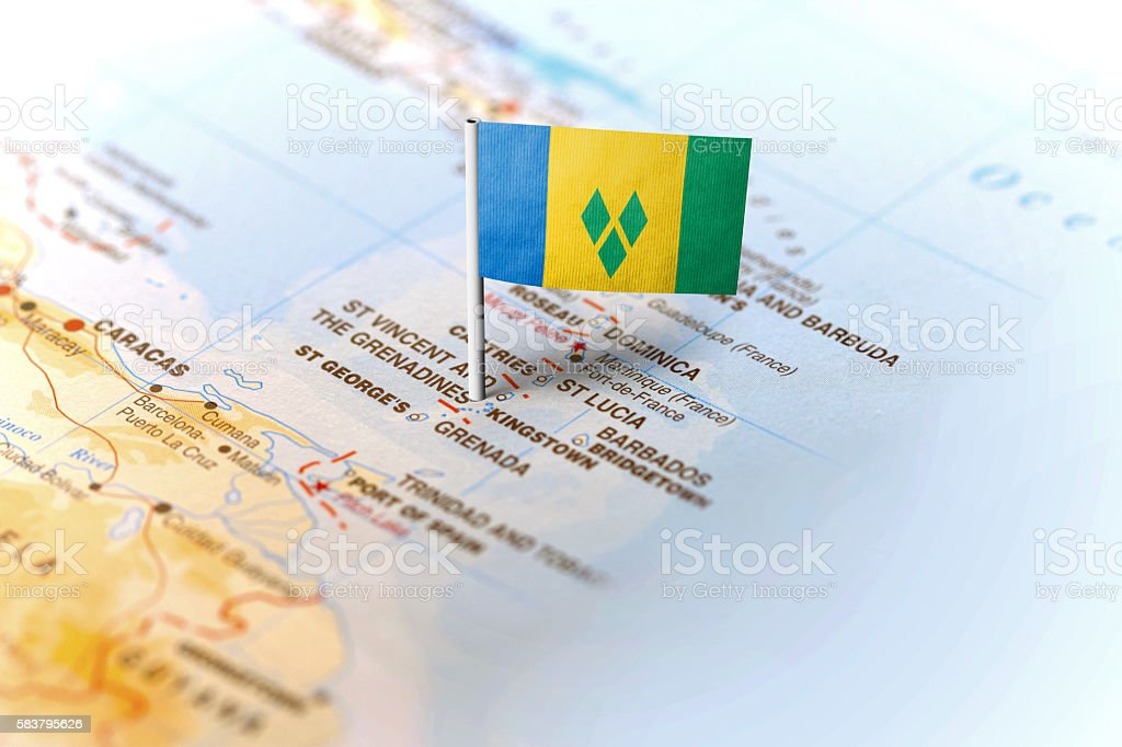 St Vincent pinned on the map with flag stock photo