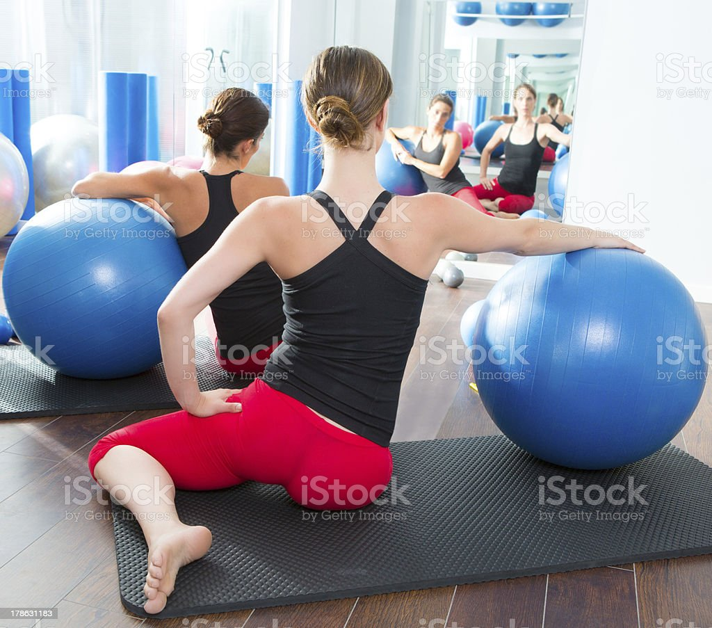stability ball in women Pilates class rear view royalty-free stock photo