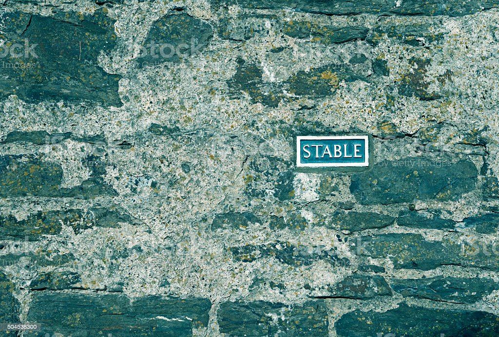 Stable sign on medieval city wall in Conwy Wales stock photo