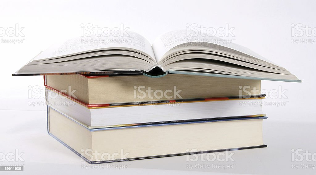 Stack and open book royalty-free stock photo