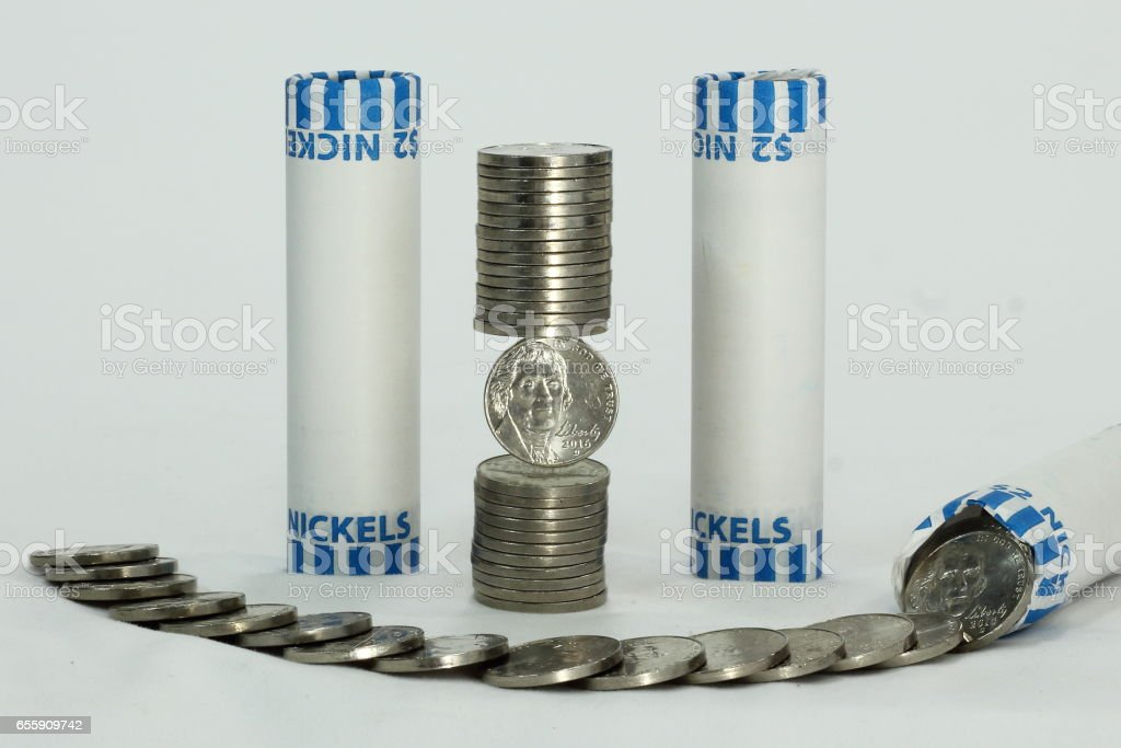 Stack and Rolls of Nickels stock photo