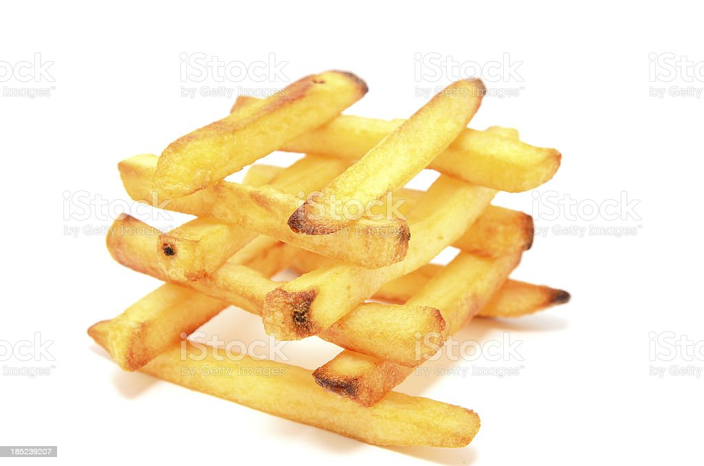 Stack arrangement of french fries on white background stock photo