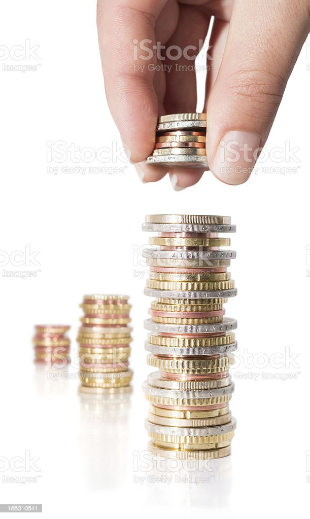 stack coins with hand royalty-free stock photo
