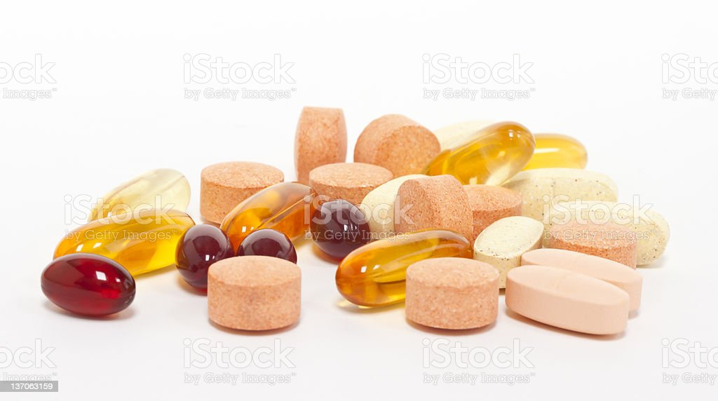 Stack of a variety of supplements in tablets and gel form stock photo