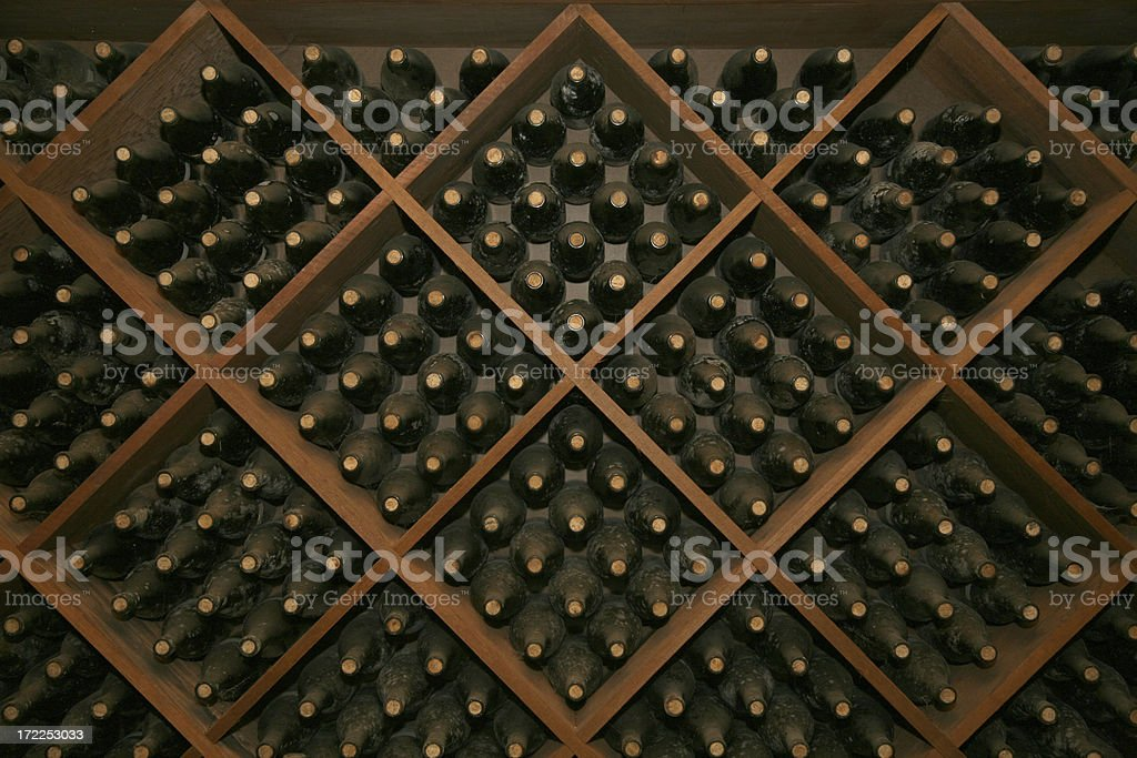 Stack of Aging Wine Bottles stock photo