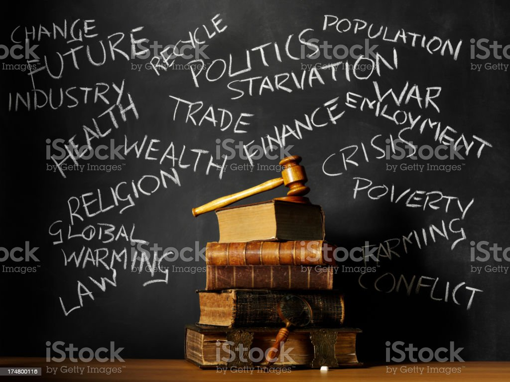 Stack of Antique Books with Words on a Blackboard royalty-free stock photo
