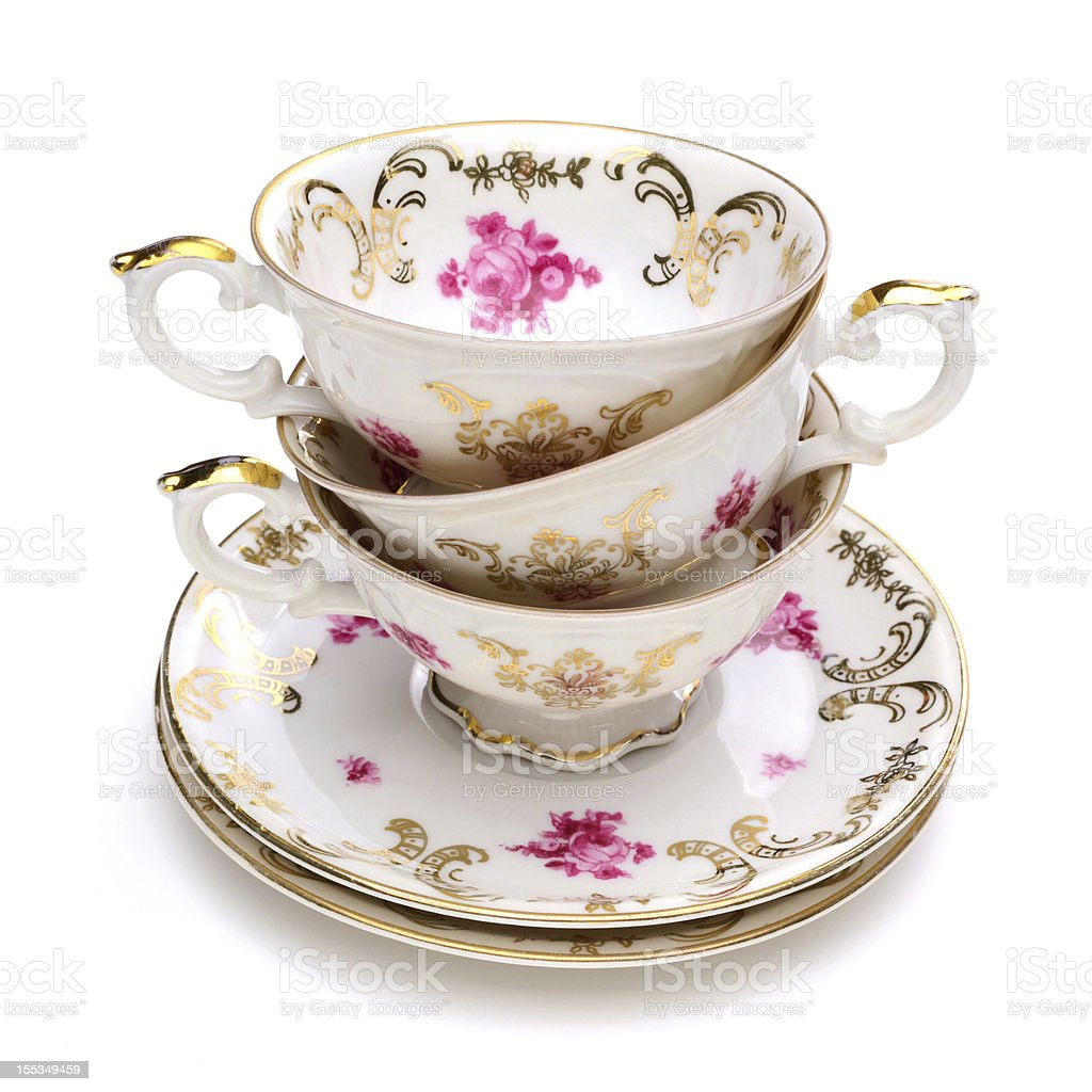 Stack of antique tea cups stock photo