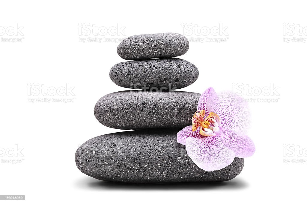 Stack of balanced stones and an orchid stock photo