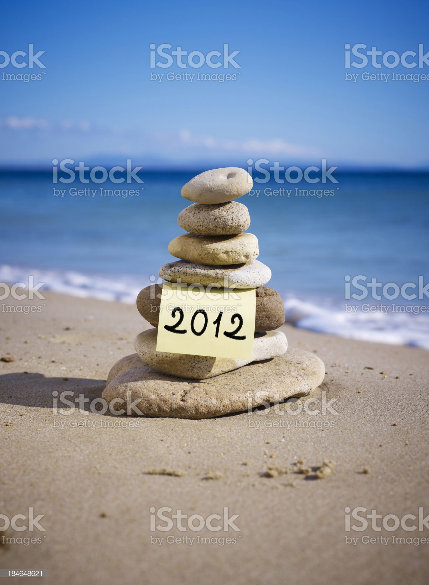 Stack of balanced stones on the beach royalty-free stock photo