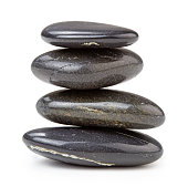 stack of black pebbles isolated on white