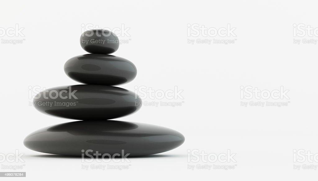 Stack of black zen stones on white floor. stock photo