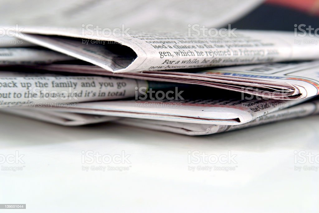 Stack of blank and white ink newspapers stock photo