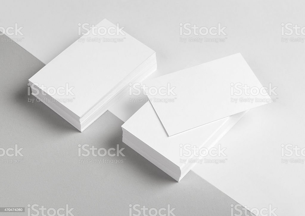 A stack of blank business cards and letterhead stock photo