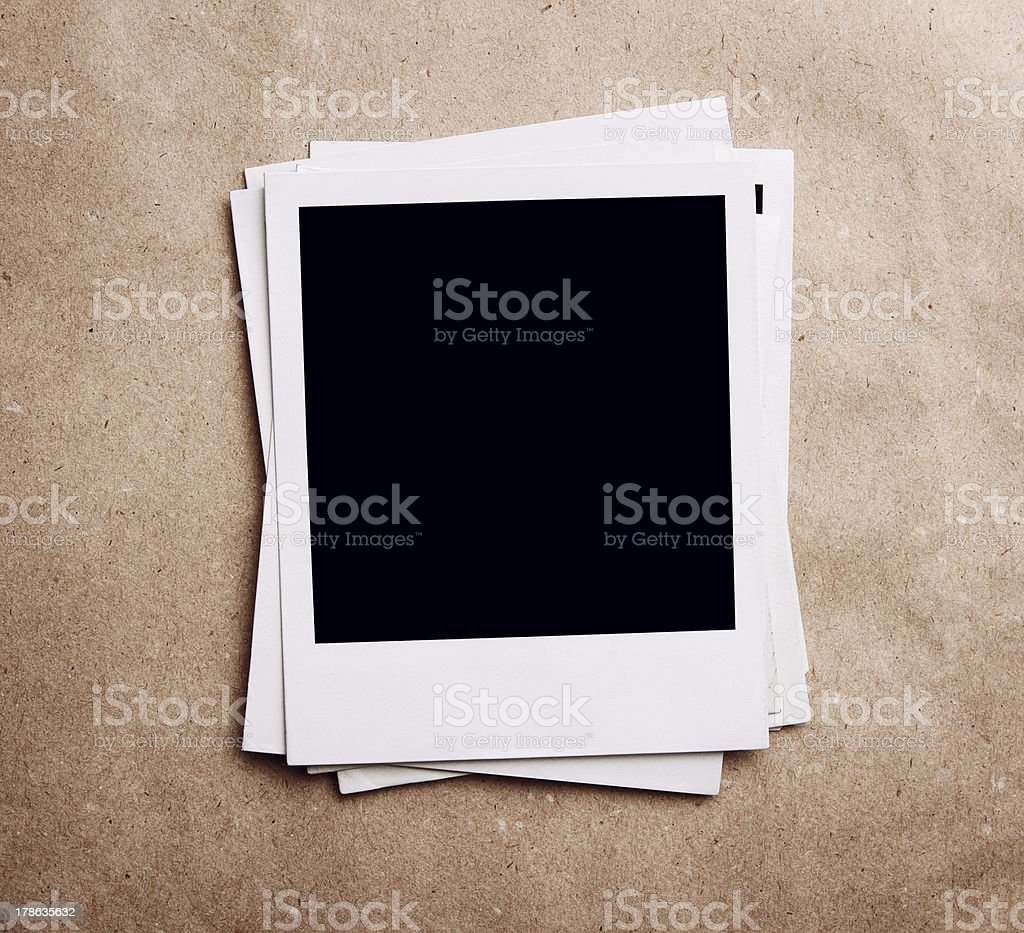 Stack of blank vintage photos stock photo