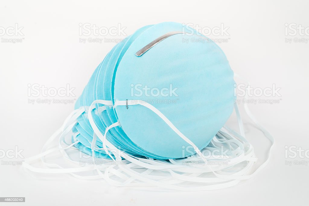Stack of Blue Dust Masks. stock photo