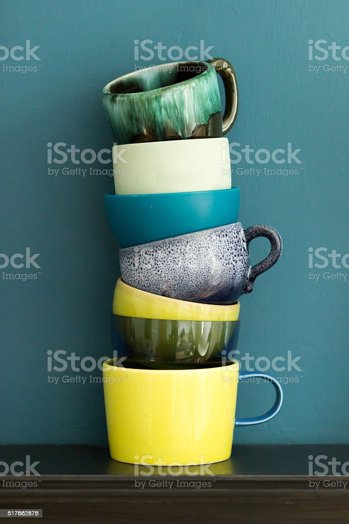 Stack of blue green and yellow cups stock photo