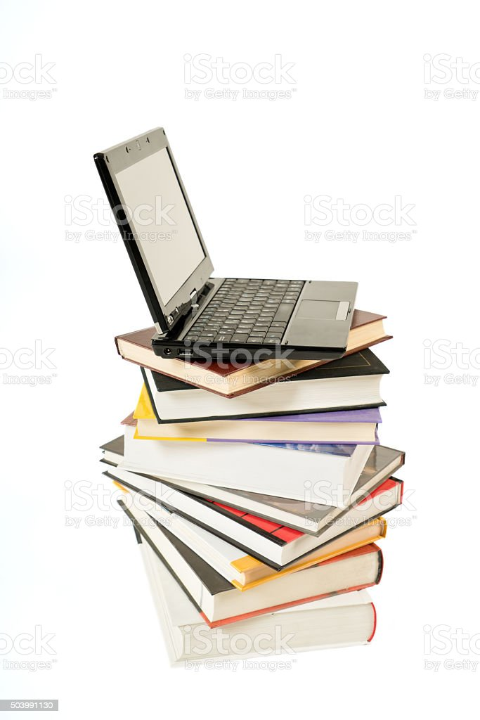 Stack of book and laptop isolated on white stock photo