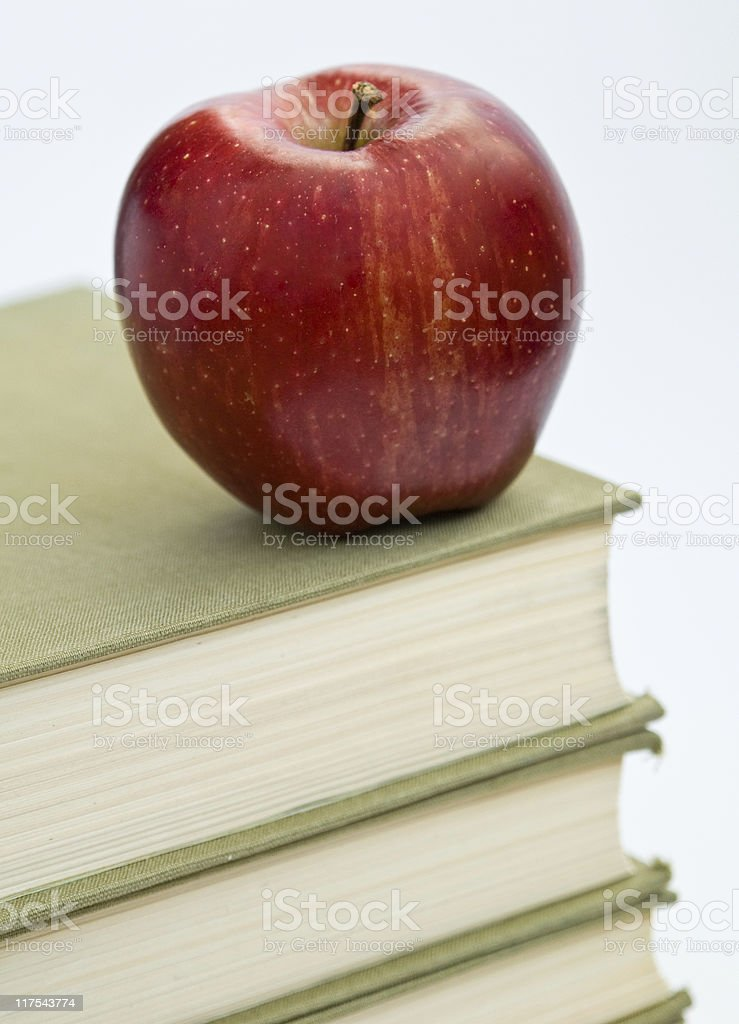 stack of books & an apple royalty-free stock photo