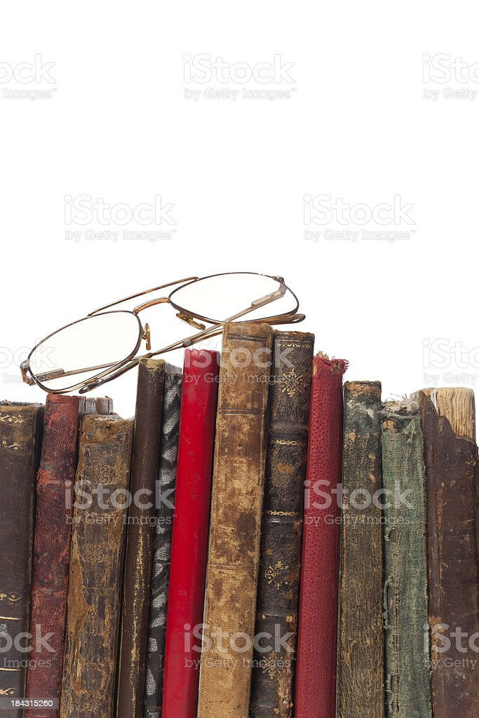 Stack of books and glasses on white background royalty-free stock photo