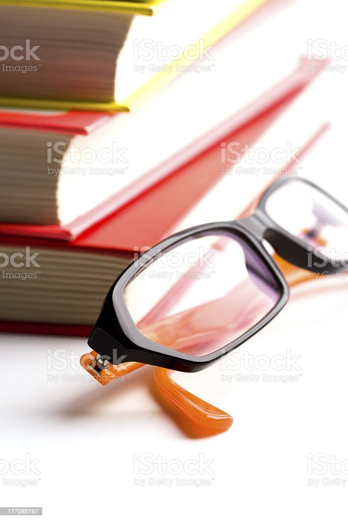 stack of books and glasses royalty-free stock photo