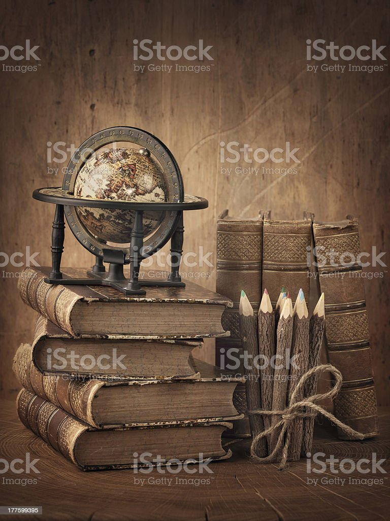Stack of books and globe royalty-free stock photo