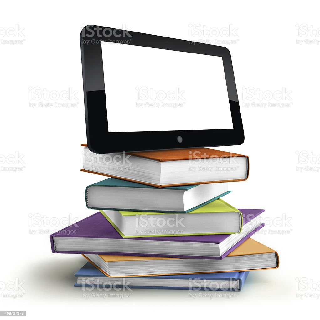 stack of books and laptop stock photo