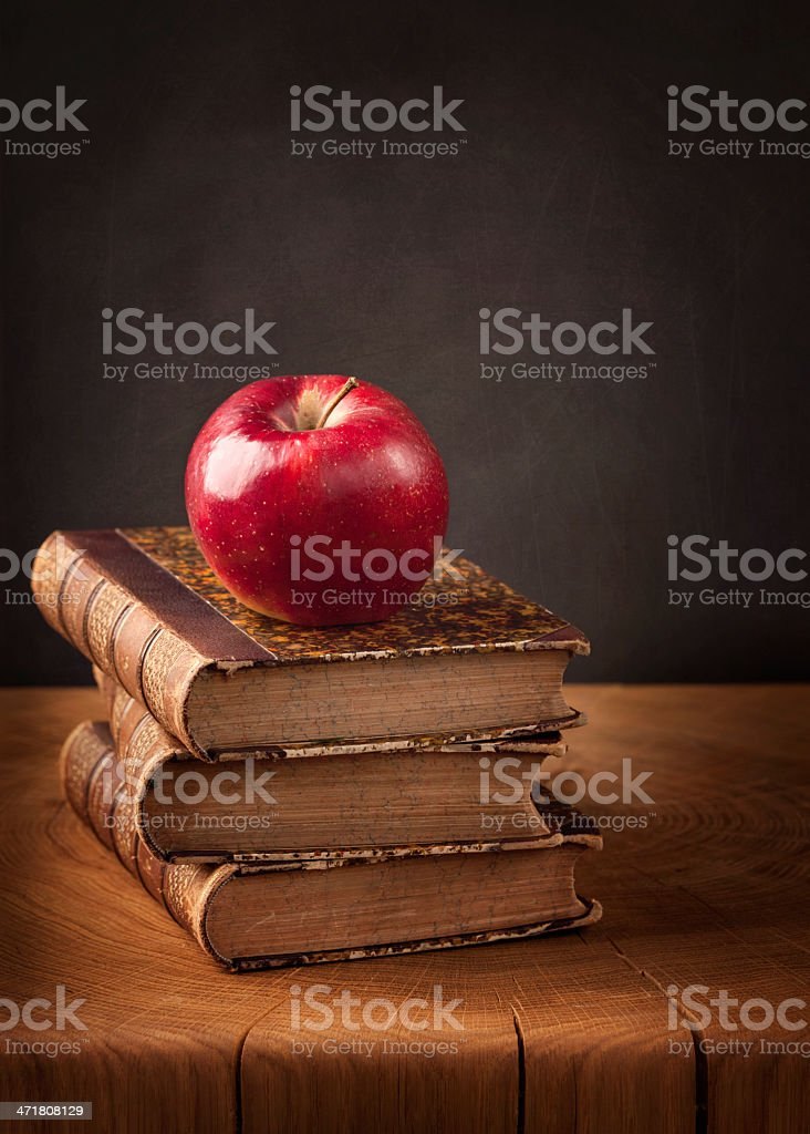 Stack of books and red apple royalty-free stock photo