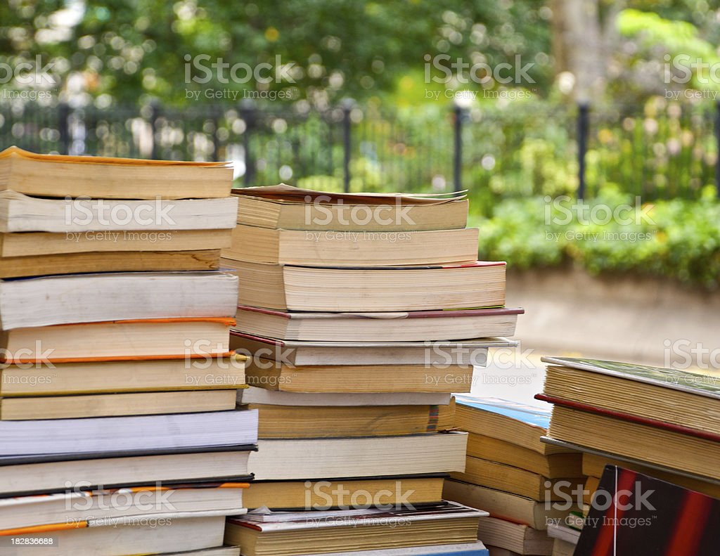 Stack of books being sold by a street vendor, NYC royalty-free stock photo
