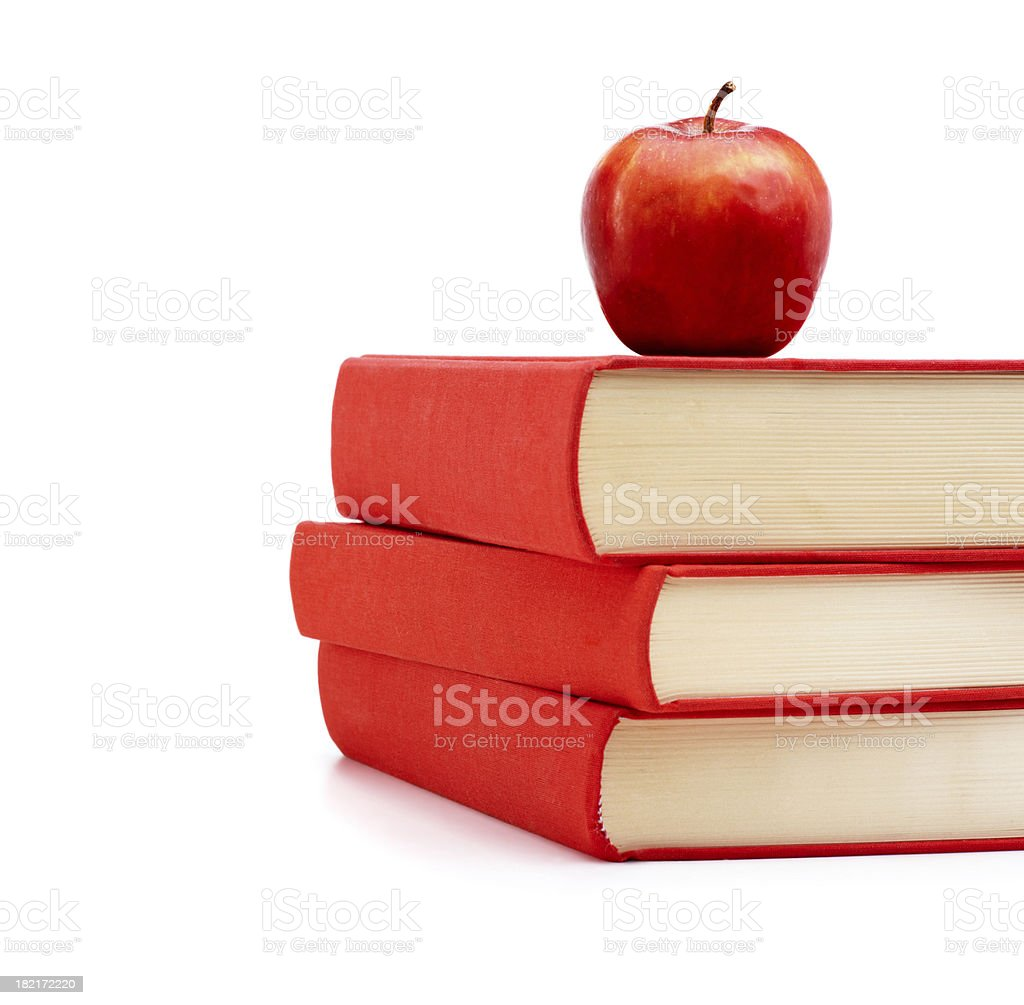 Stack of books with an apple on top royalty-free stock photo