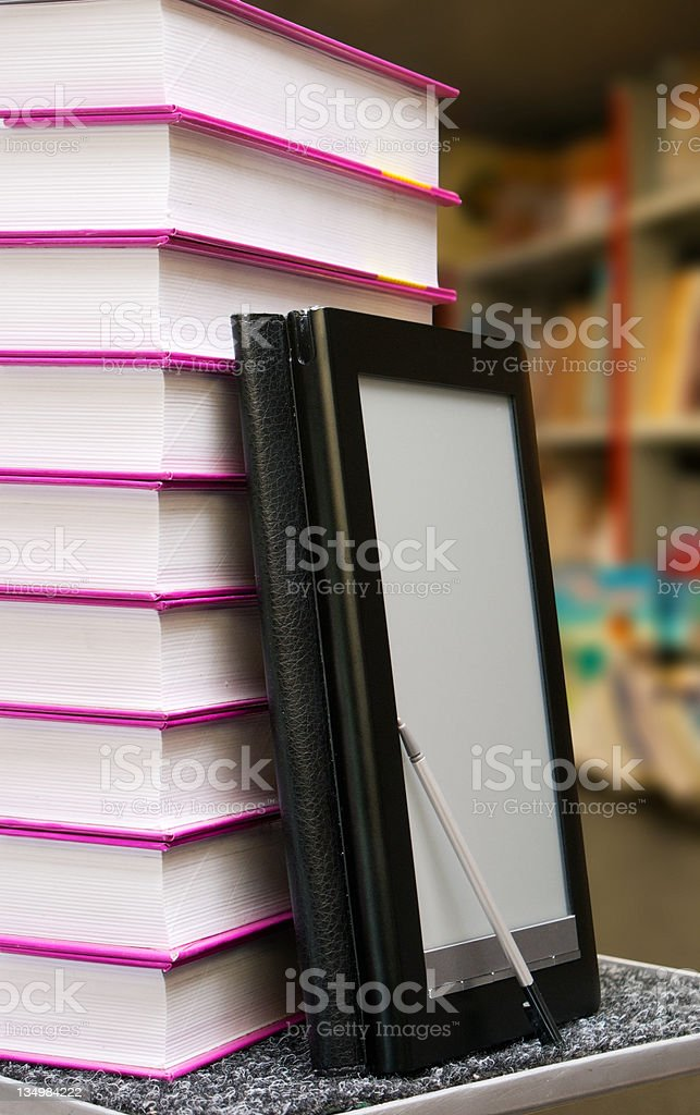 Stack of books with electronic book reader royalty-free stock photo