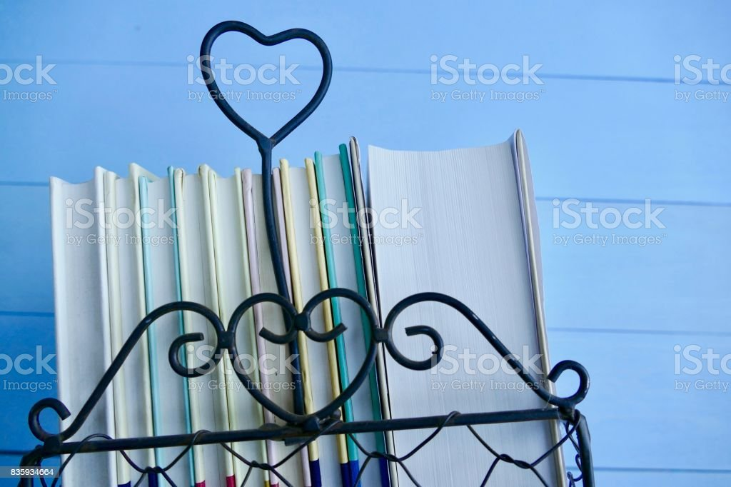 Stack of books with heart symbol stock photo