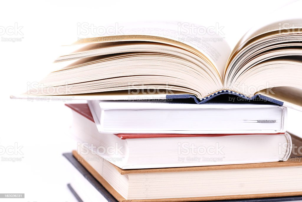 Stack of books with the book on top cracked open  royalty-free stock photo