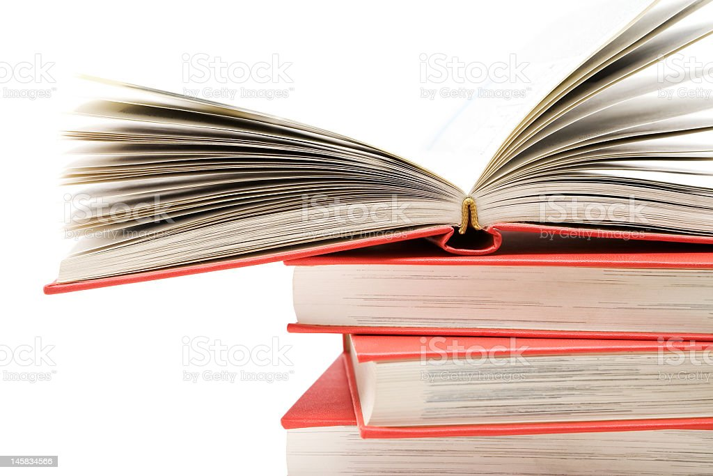 Stack of books with the top one open for studying royalty-free stock photo