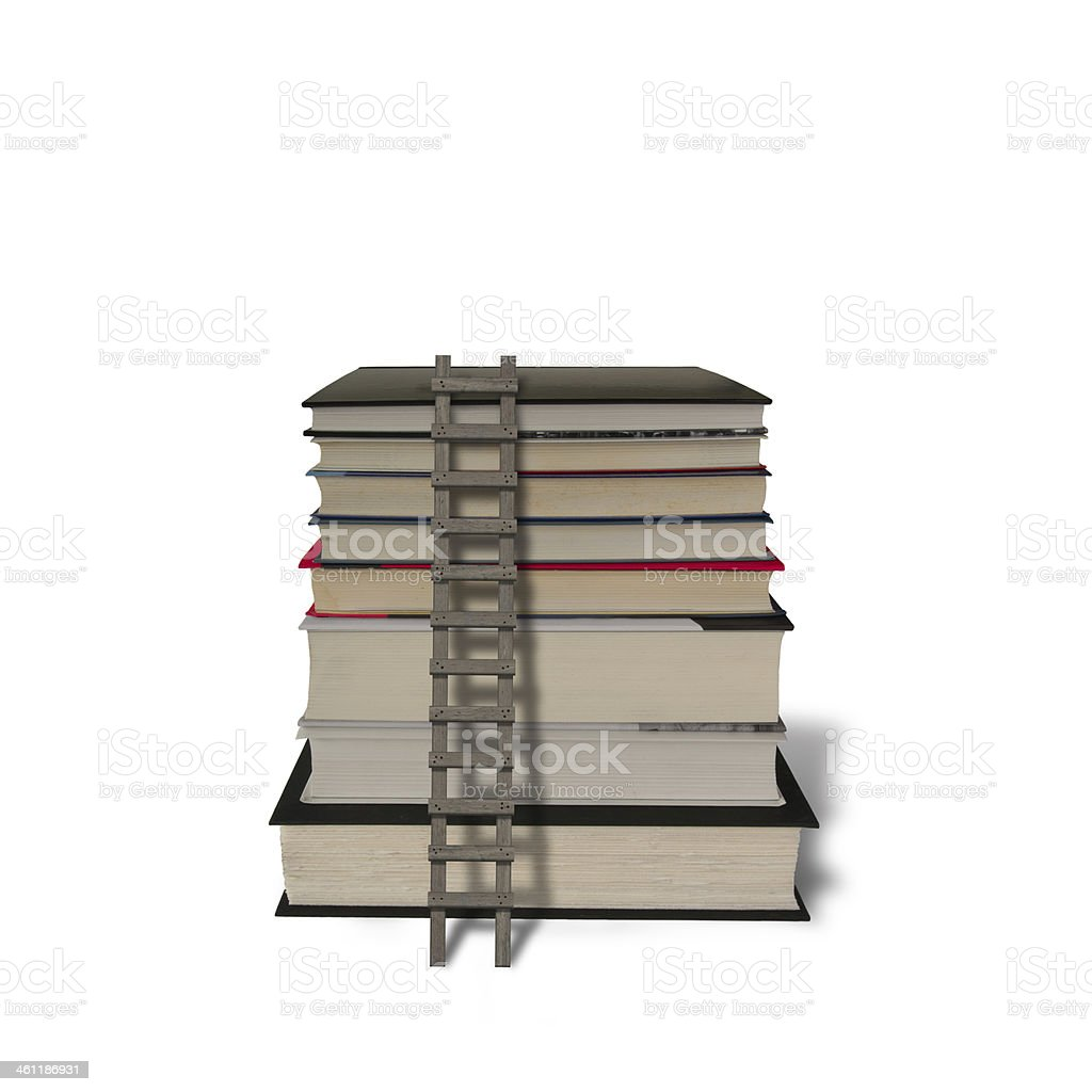 Stack of books with wooden ladder isolated in white royalty-free stock photo