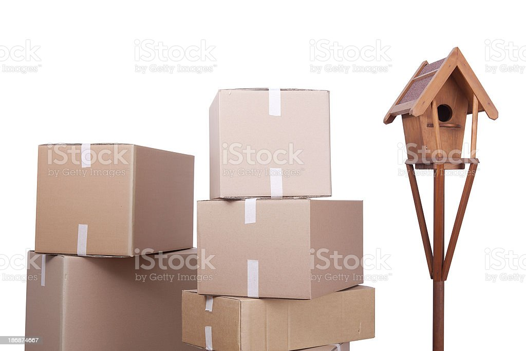 Stack of boxes and birdhouse for moving house concept royalty-free stock photo