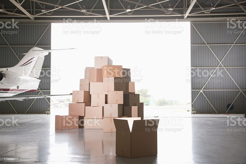 Stack of boxes in hangar royalty-free stock photo