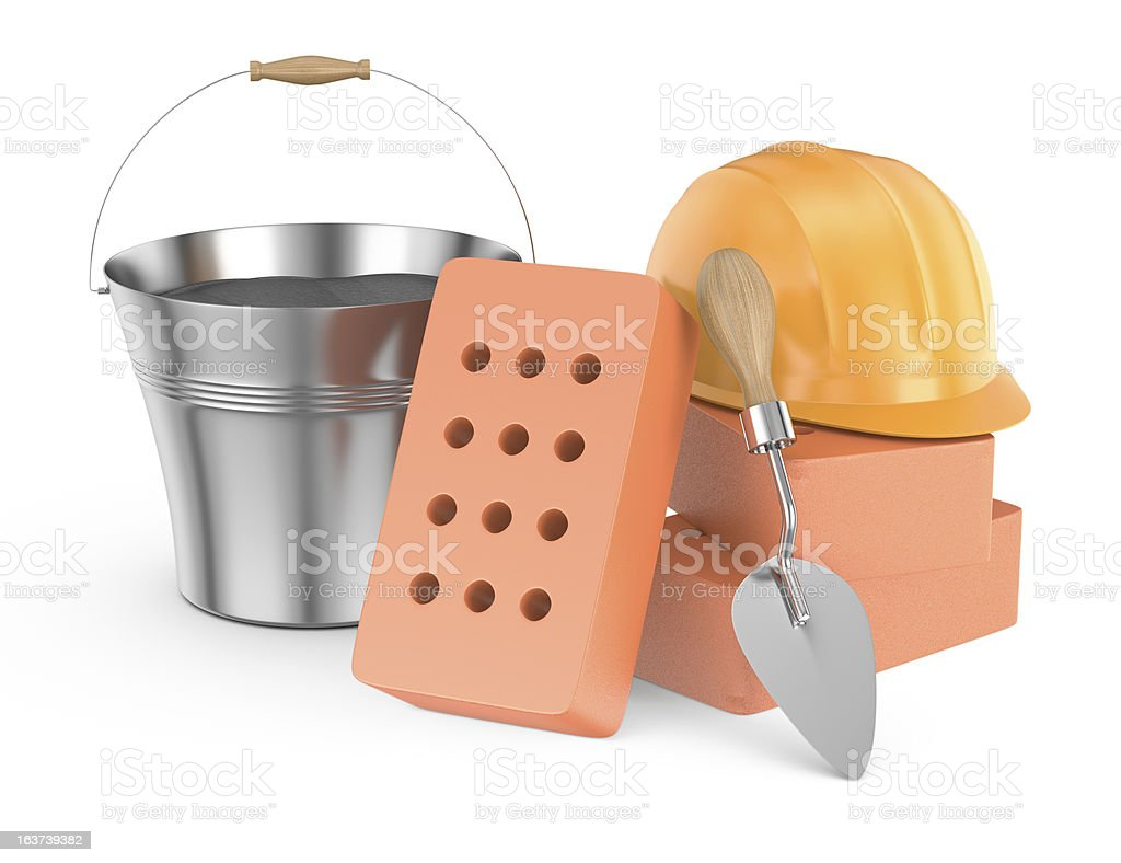 stack of bricks, trowel and helmet royalty-free stock photo