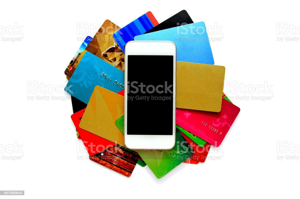 stack of bright colorful discount plastic cards and mobile phone. stock photo