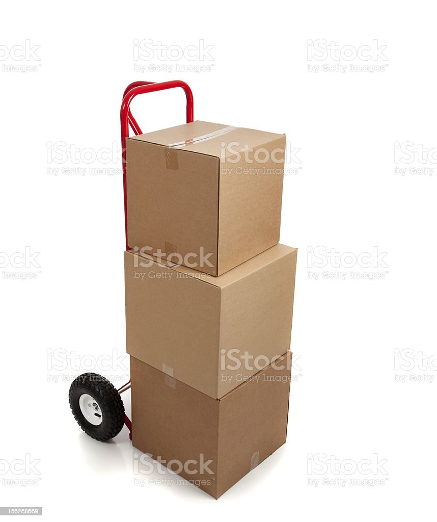 Stack of brown cardboard boxes on a hand truck, dolly royalty-free stock photo