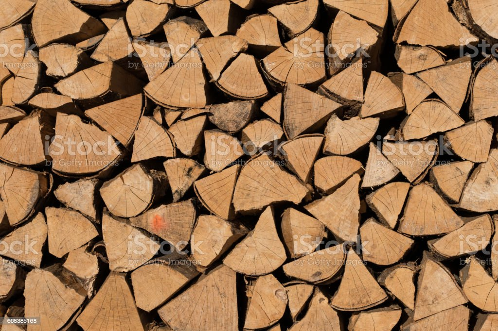 Stack of brown fire wood as background stock photo