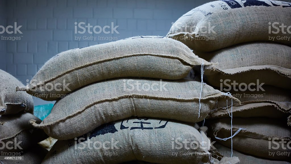 stack of burlap sacks with coffee beans stock photo