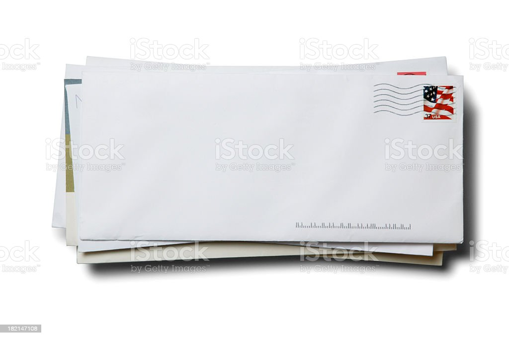 Stack of business envelopes with cancelled stamp on white background stock photo