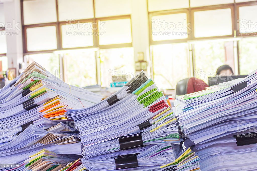 Stack of business report paper files with black clips stock photo
