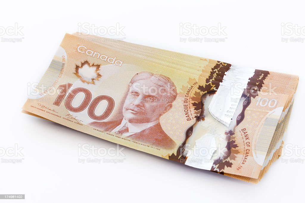 Stack of Canadian $100 bills  2012 stock photo