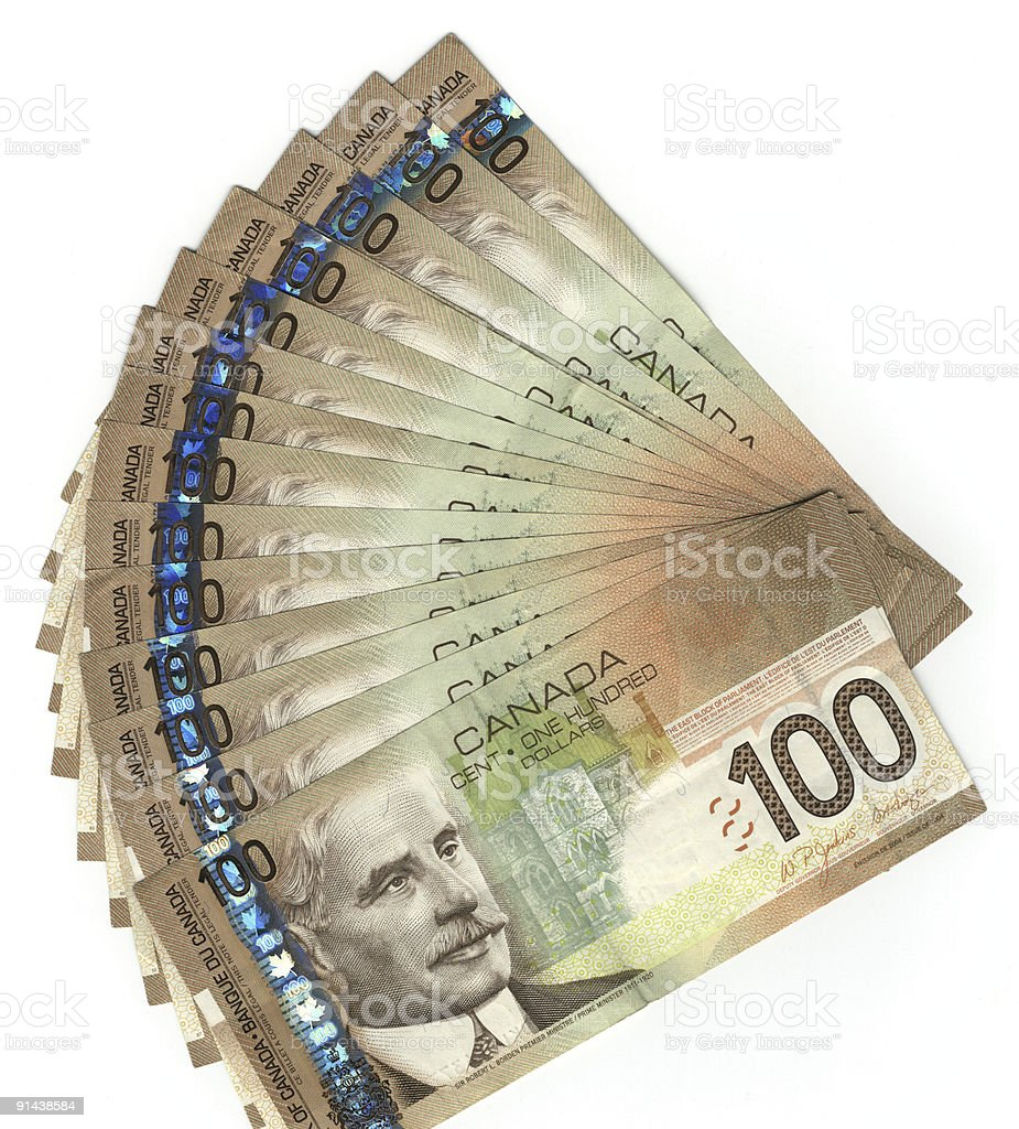 A stack of Canadian hundred dollar bills isolated on white stock photo