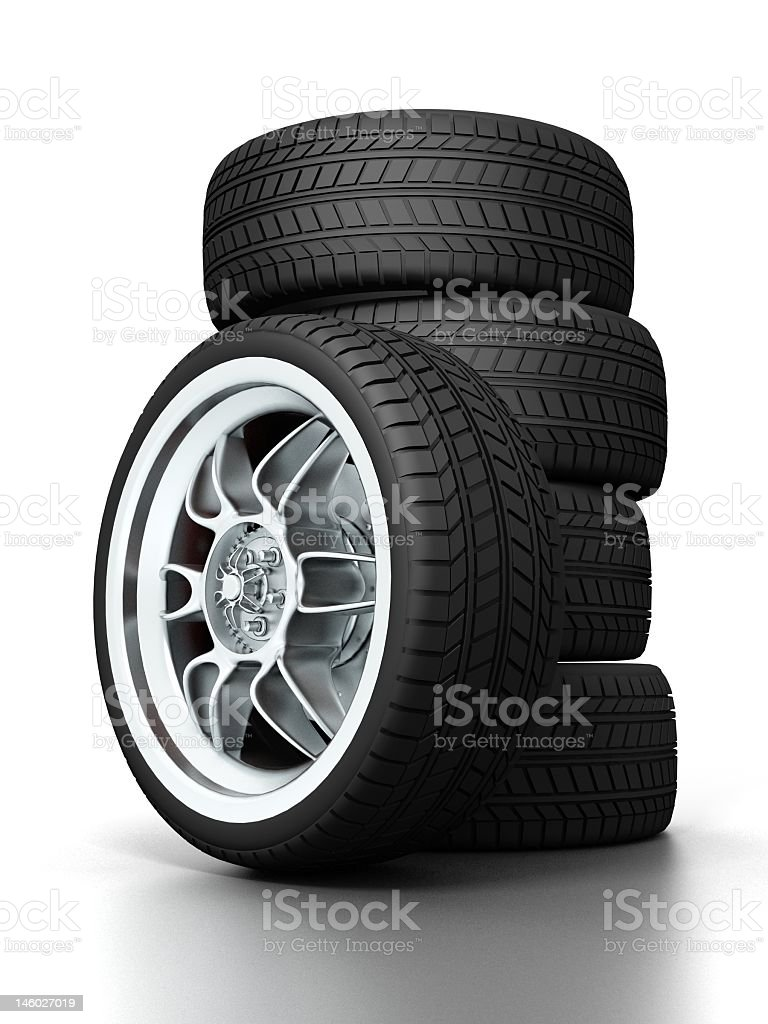 A stack of car wheels on a white background royalty-free stock photo